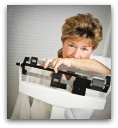 woman on scales: losing weight after menopause